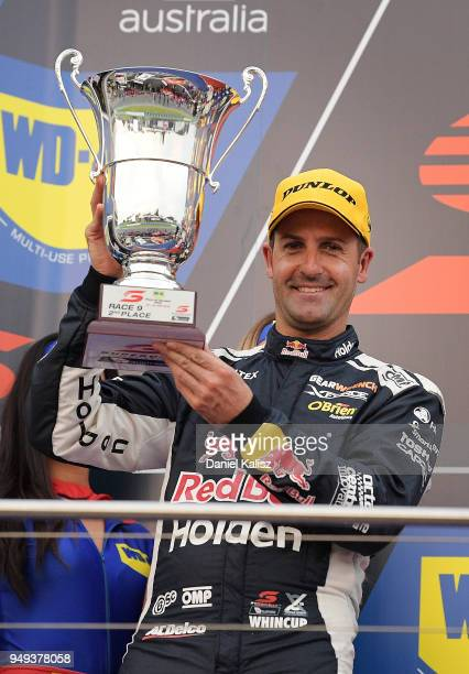 2nd place Jamie Whincup driver of the Red Bull Holden Racing Team Holden Commodore ZB celebrates on the podium during the Supercars Phillip Island...