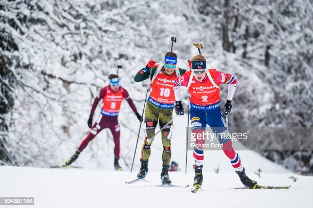 2nd place Johannes Thingnes Boe of Norway 3rd place Erik Lesser of Germany and 4th place Anton Shipulin of Russia compete during the IBU Biathlon...