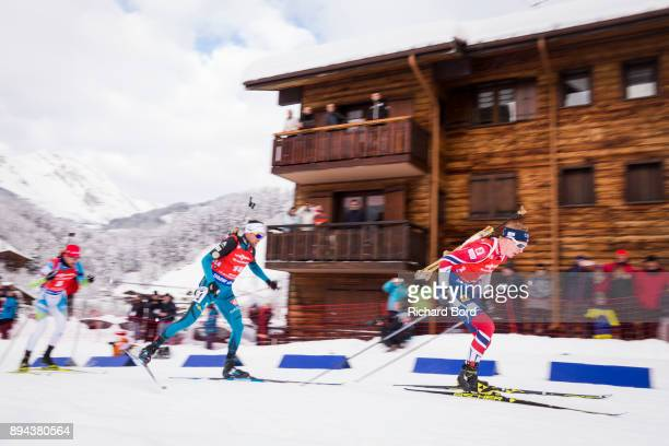 2nd place Johannes Thingnes Boe of Norway and 17th place Simon Desthieux of France compete during the IBU Biathlon World Cup Men's Mass Start on...