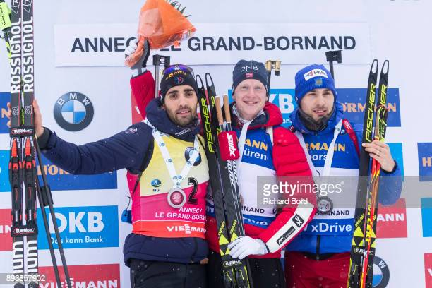 2nd place Martin Fourcade of France 1st place Johannes Thingnes Boe of Norway and 3rd place Anton Shipulin of Russia pose on the podium after the IBU...