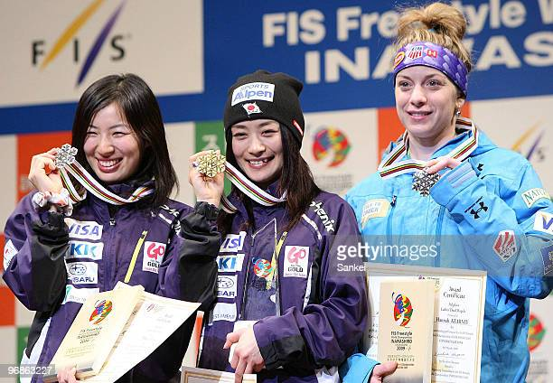 2nd place Miki Ito winner Aiko Uemura and 3rd place Hannah Kearney of US pose for photographs during the Women's dual moguls medal ceremony during...