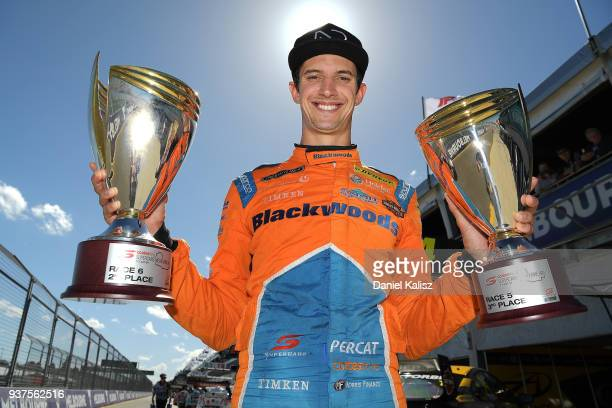 2nd place Nick Percat driver of the Brad Jones Racing Commodore ZB poses for a photo with his trophies during race 4 for the Supercars Australian...