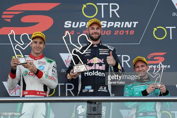 2nd place Rick Kelly driver of the Nissan Motorsport Nissan Altima 1st place Shane Van Gisbergen driver of the Red Bull Holden Racing Team Holden...