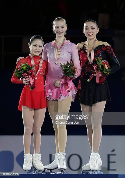 2nd place Satoko Miyahara of Japan 1st place Polina Edmunds of USA and 3rd place Rika Hongo of Japan pose on the podium after the medals ceremony of...