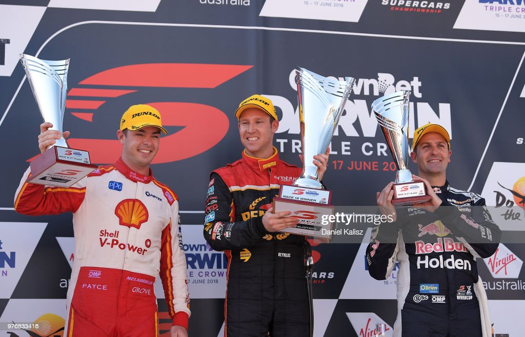 2nd place Scott McLaughlin driver of the #17 Shell V-Power Racing Team Ford Falcon FGX, 1st place David Reynolds driver of the #9 Erebus Penrite Racing Holden Commodore ZB and 3rd place Jamie Whincup driver of the #1 Red Bull Holden Racing Team Holden Commodore ZB celebrate on the podium during race 16 for the Supercars Darwin Triple Crown at Hidden Valley Raceway on June 17, 2018 in Darwin, Australia.