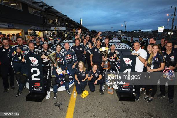 2nd place Shane Van Gisbergen driver of the Red Bull Holden Racing Team Holden Commodore ZB and 1st place Jamie Whincup driver of the Red Bull Holden...