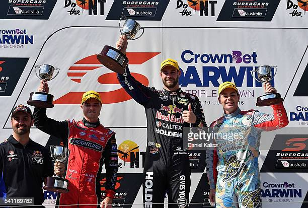 2nd place Tim Slade driver of the Freightliner Racing Holden Commodore VF 1st place Shane Van Gisbergen driver of the Red Bull Racing Australia...