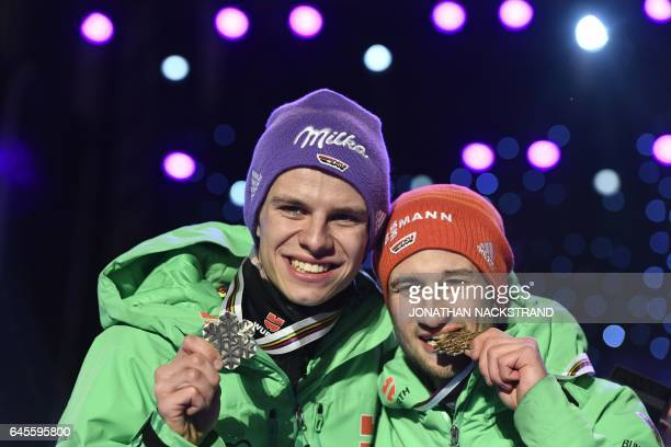 2nd placed Andreas Wellinger and 3rd placed Markus Eisenbichler of Germany pose for photographers during the medals ceremony for men's ski jumping...