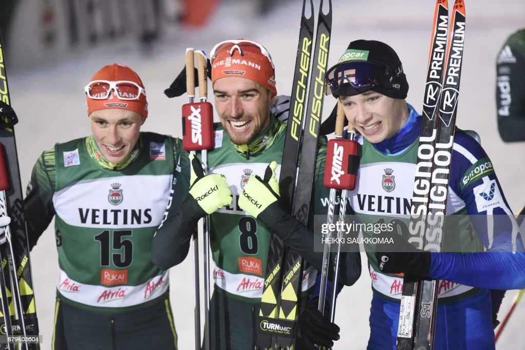 2nd placed Eric Frenzel of Germany, winner Johannes Rydzek of Germany and 3rd placed Eero Hirvonen of Finland pose after the Nordic Combined Men's Individual Gundersen 10 km competition of the FIS World Cup Ruka Nordic 2017 in Ruka, Kuusamo in northern Finland on November 26, 2017. / AFP PHOTO / Lehtikuva / Heikki Saukkomaa / Finland OUT