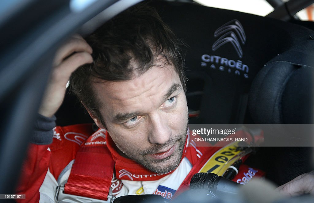 2nd placed France's Sebastien Loeb speaks to journalists after crossing the finish line of the 22nd and the last stage of Rally Sweden, FIA World Rally Championship second round in Karlstad, Sweden on February 10, 2013.