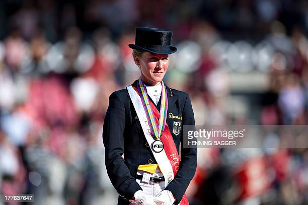 2nd placed German rider Helen Langehanenberg poses on the podium after competing in the FEI Dressage European Championship Finals in Herning Denmark...