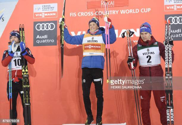 2nd placed Martin Johnsrud Sundby of Norway his compatriot and winner Johannes Hoesflot Klaebo and 3rd placed Alexander Bolshunov of Russia pose on...
