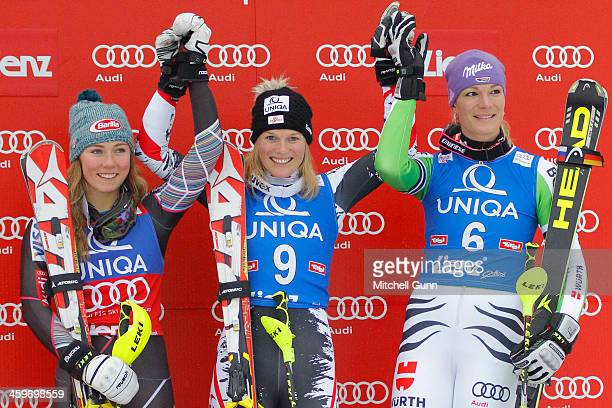 2nd placed Mikaela Shiffrin of The USA race winner Marlies Schild of Austria and 3rd placed Maria HoeflRiesch of Germany on the podium for the FIS...