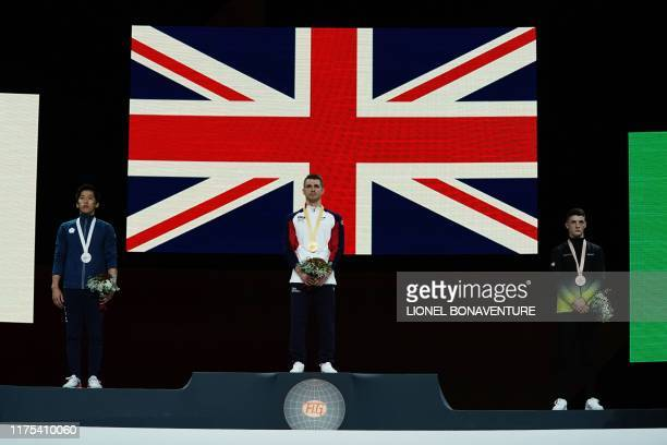 2nd placed Taiwan's Lee Chih Kai winner Great Britain's Max Whitlock and 3rd placed Ireland's Rhys Mcclenaghan listen to their national anthems...