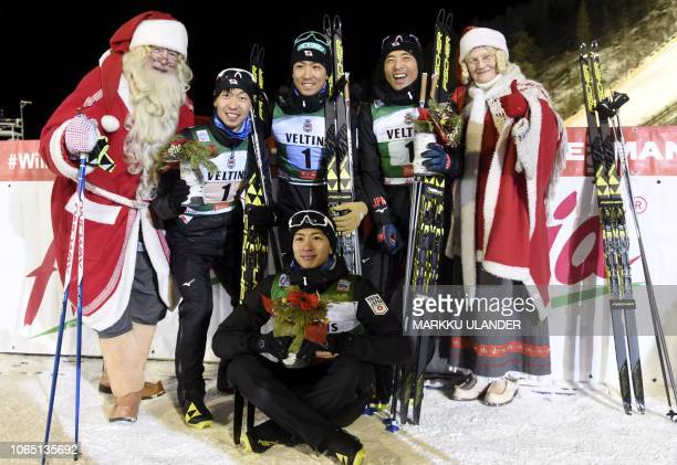 2nd placed team Japan from left Hideaki Nagai Go Yamamoto Akito Watabe and Yoshito Watabe celebrating with Santa Claus and Mother Christmas after...