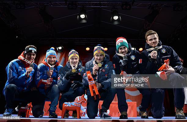 2nd placed team Russia Nikita Kriukov and Alexey Petukhov winning team Norway Finn Haagen Krogh and Petter Jr Northug and 3rd placed team Italy...
