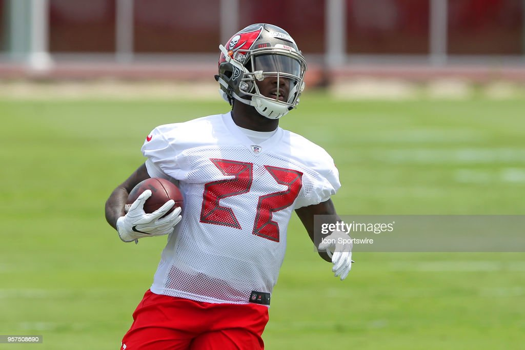 2nd round pick Ronald Jones II (22) carries the ball during the Tampa Bay Buccaneers Rookie Minicamp on May 11, 2018 at One Buccaneer Place in Tampa, Florida.