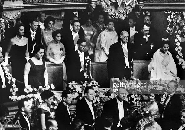 French President General de Gaulle and his wife King Bhumibol Adulyadej of Thailand and his wife attend a show at the Opera de Paris 14 October 1960...