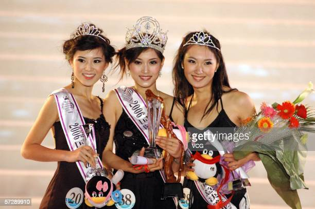 2nd runnerup Liang Shuang champion Yu Chenyan and 1st runnerup Zhang Xue pose for pictures after winning the Chinese Region's 2006 Miss Tourism Queen...