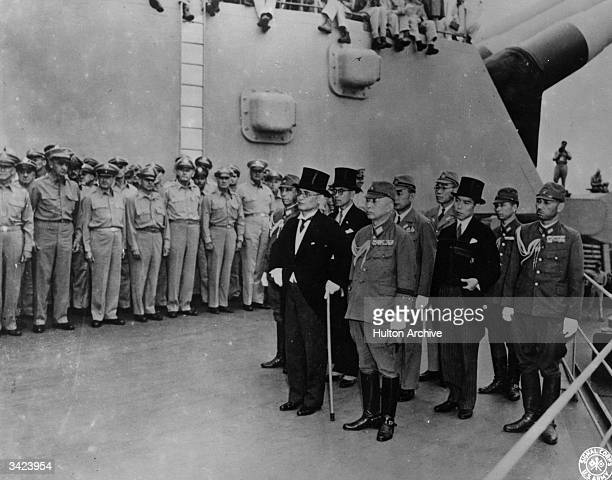 The Japanese delegation arrives on board the USS Missouri in Tokyo Bay, to sign the Instrument of Surrender, headed by Mamoru Shigemitsu, the...