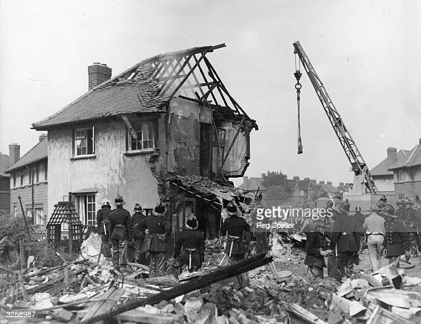 Firemen and rescue workers begin clearing up the debris after a Viking airliner crashed through a row of four council houses in West London All three...