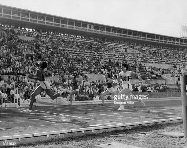 The finish of the 100 metres race at the Olympics in Rome with Wilma Rudolph taking the gold and Dorothy Hyman the silver and Italy's G Leone the...