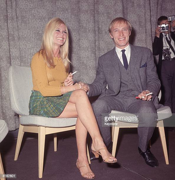 French film actress Brigitte Bardot and British actor director Mike Sarne her costar in the film 'Two Weeks In September' at London Airport