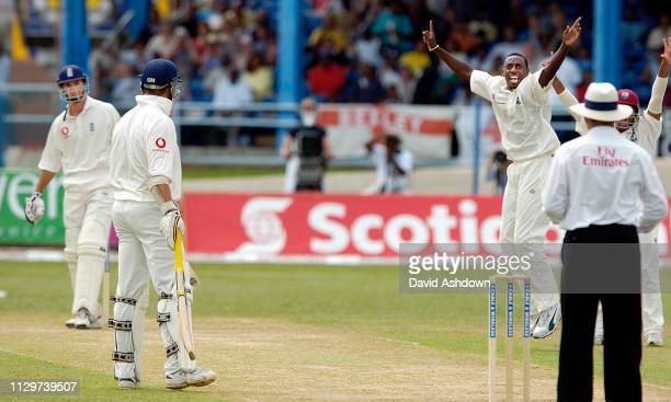 2nd TEST 2nd DAY 20/3/2004 AT THE QUEENS PARK OVAL PORT OF SPAIN TRINIDAD COLLINS TAKES THE WICKET OF VAUGHAN.