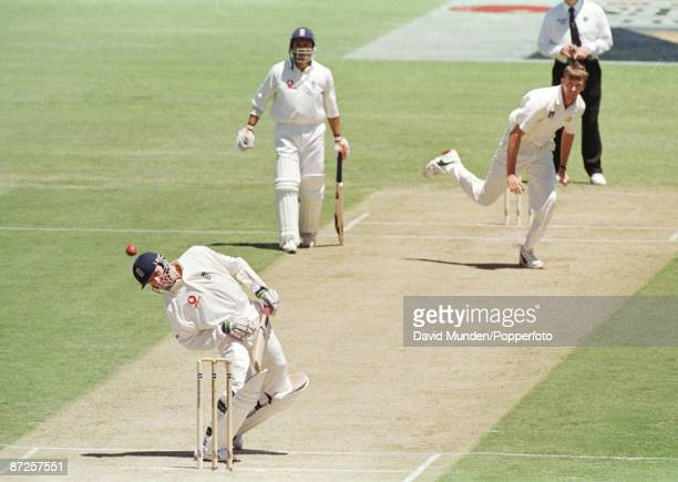 2nd test Australia v England in Perth 28/11/98 DOMINIC CORK evades a bouncer from GLENN McGRATH