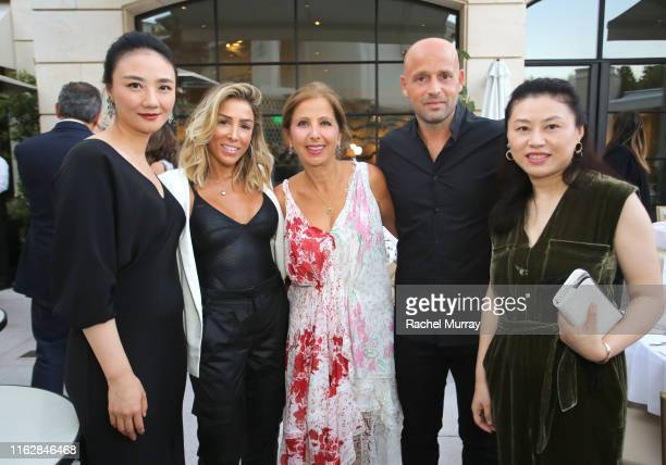 2ndLR Ilana Kugel Karine Ohana Marcelo Kugel and Isabelle Zhuang attend the Ohana Co LA Summer Party at the Peninsula Hotel on August 19 2019 in...