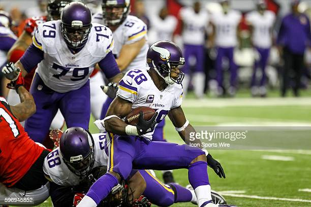 Minnesota Vikings running back Adrian Peterson changes directions running the ball in second half action of the game between the Vikings and the...