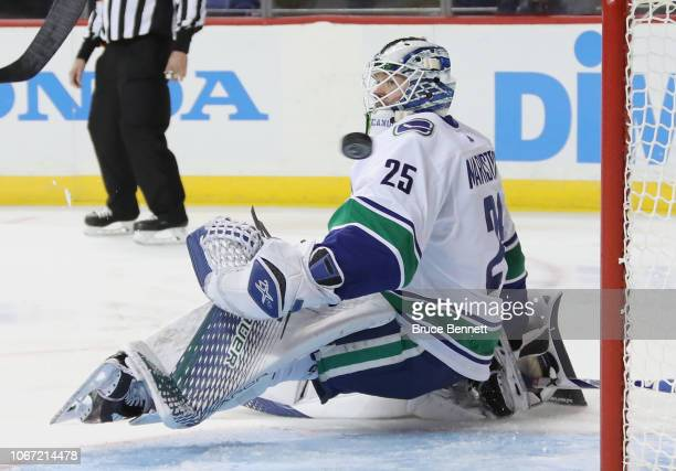 A 2pshot by the New York Islanders sails past Jacob Markstrom of the Vancouver Canucks at the Barclays Center on November 13 2018 in the Brooklyn...