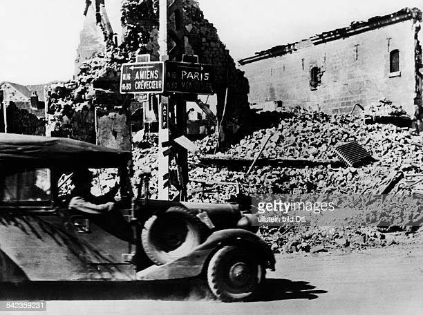 Ww: campaign in the west 1940: German military vehicle passes a roadsign to Parisabout