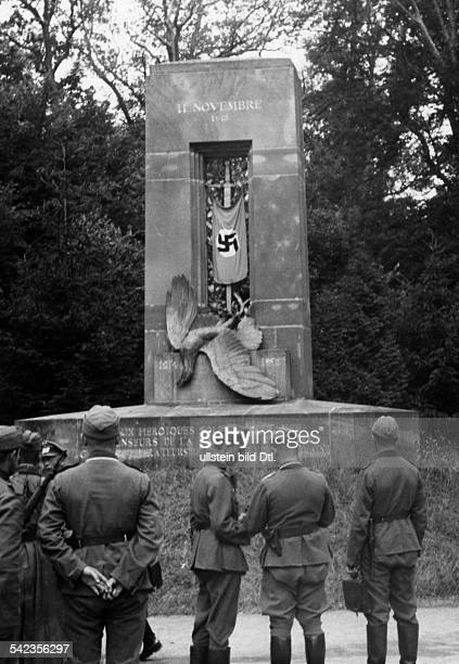 2ww campaign in the west 1940 German troops in compiegne forest The svastika flag at the victory memorial of 1918 photo Heinrich Hoffmann