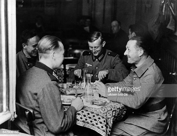2ww german occupation of france from 230640 on Alsace German and french soldies fron the Alsace taking together a meal in an alsacian restaurant...