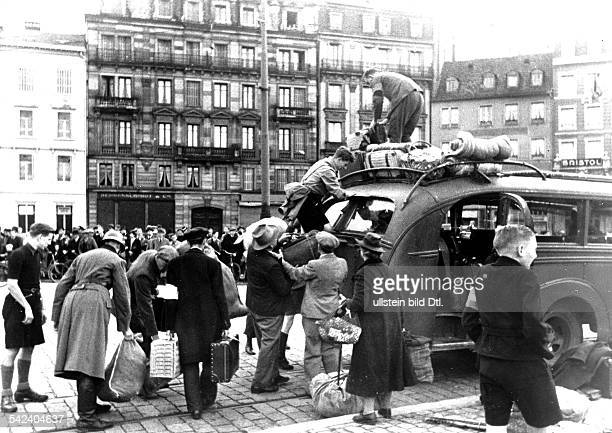 2ww german occupation of france from 230640 on Alsatians who had been evacuated by the french government return to the Alsace Busses will bring them...