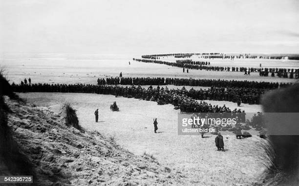 2wwcampaign in the west 1005 british and french troops waiting among the dunes of Dunkirk beach for their evacuation about