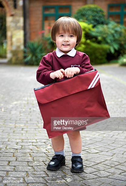 2-year old's first day at school - satchel bag stock photos and pictures