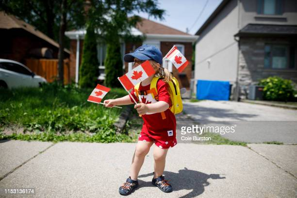Year-old Blair Berner dances to music from a passing float in the East York Canada Day Parade on July 1, 2019 in Toronto, Canada. Canada Day...