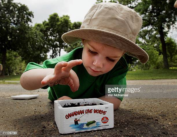 2yearold Davis Cowper of Annandale Virginia tries to find the perfect worm for his hook during the Fishing on the Mall event to celebrate National...