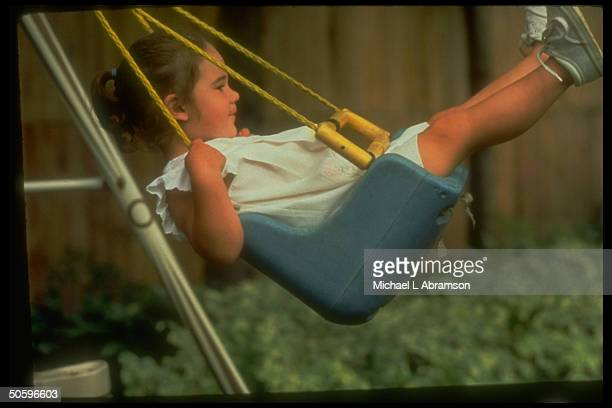 2yrold Jessica DeBoer playing on swing re adoptive parents loss of custody battle resulting in her imminent return to biological parents