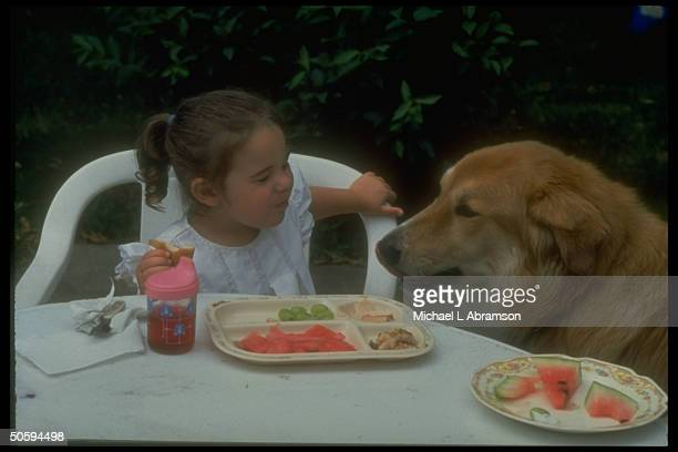 2yrold Jessica DeBoer sharing lunch w dog Miles re adoptive parents loss of custody battle resulting in her imminent return to biological parents