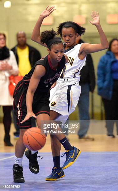 Georgetown Visitation's Alexis Gray tried not to foul Stonewall Jackson's Genesis Parker as drive around her in the Title IX Holiday Invitational...