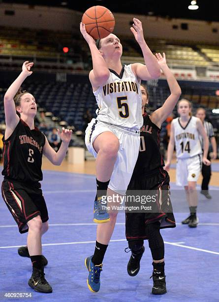 Georgetown Visitation's Maeve Carroll drives to the basket in the game against Stonewall Jackson in the Title IX Holiday Invitational Classic at the...
