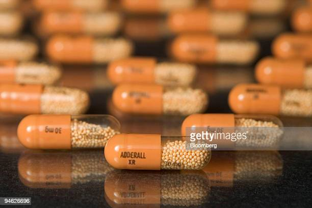 30mg tablets of Shire Plc's Adderall XR are arranged in a Cambridge Massachusetts pharmacy on Tuesday August 15 2006 Shire Plc shares rose after the...