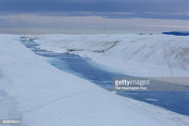 A 30milelong meltwater river runs through Petermann glacier on August 27 2016 Peterson's ice shelf broke off a piece roughly four times as large as...