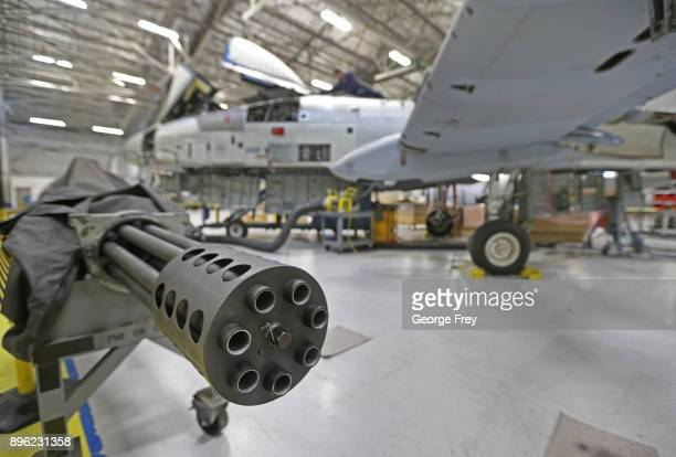A 30mm cannon from an A10 sits to the side as a aircraft mechanic works an A10 Thunderbolt Warthog on December 20 2017 at Hill Air Force base in...