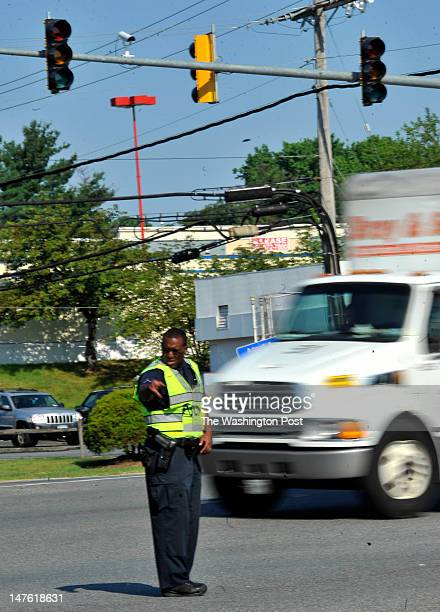 Prince Georges County police officer directing traffic at the intersection of LaurelBowie Road and Contee Road because of traffic lights being out on...
