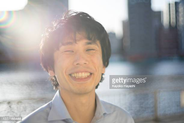 30s asian man portrait - permed hair stock pictures, royalty-free photos & images
