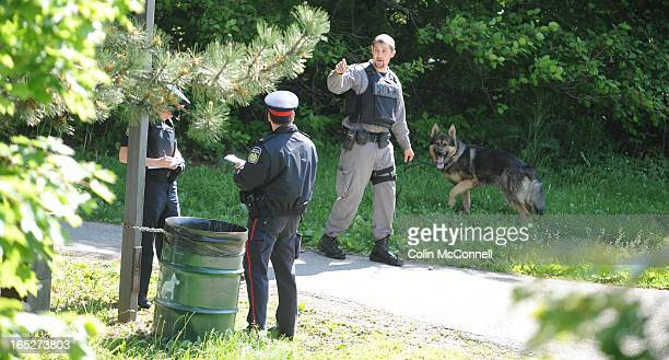 MAY 30th 2009pics of scene of homicide at 6860 glen erin road in peel this morning police at the scene with dogs are looking for clues as the...